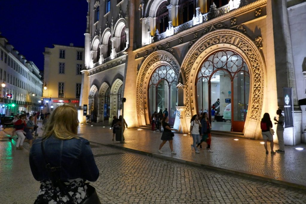 The Neo-Manueline (1886-87) facade of Lisbon's Rossio Railway Station at night.