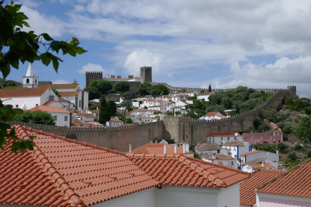 The walled medieval town of Óbidos. Here is where to try the delicious sour cherry liqueur ginjinha. The castle is now a pousada (hotel).