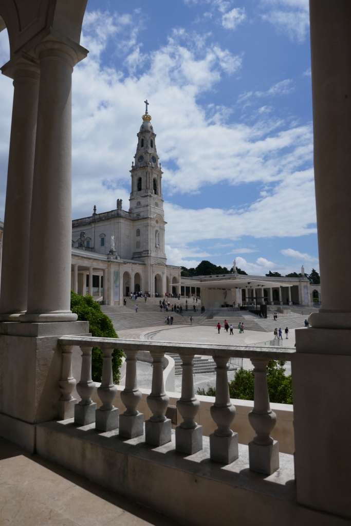 The basilica (1928-1953) and outdoor altar at Fátima, from the colonnade. Across the enormous plaza is a new church (2007) which holds 9,000 people.