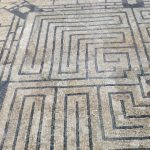 A Roman mosaic floor at Conímbriga features a labyrinth with a pointy-horned Minotaur in the centre.