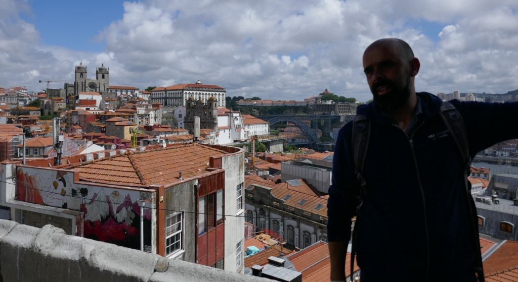 On the Taste Porto Food Tour (www.tasteporto.com), the cathedral is on this side of the Douro River, and Ricardo points toward the port wine cellars of Vila Nova de Gaia on the other.