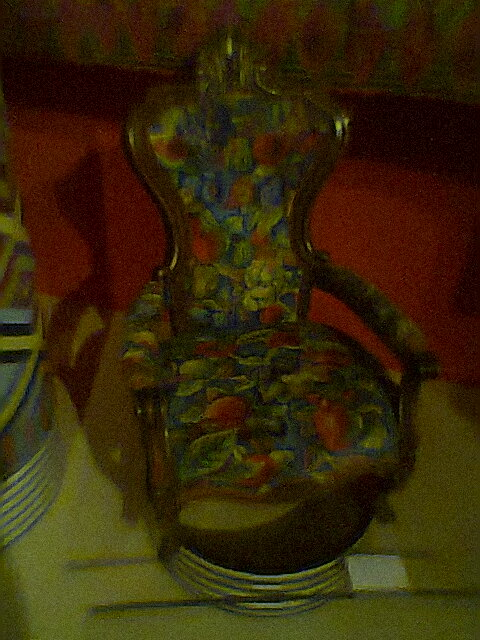 The needlepoint stitched chair was gorgeous.