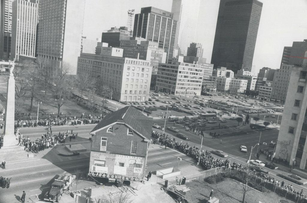 Moving Campbell House on March 1, 1972, on giant dollies, into its new location on University Avenue